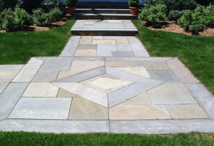 Natural stone walkway in front of a home