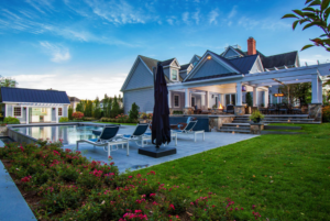 Backyard pool and patio view of a home designed by Ambrosio Landscape Solutions