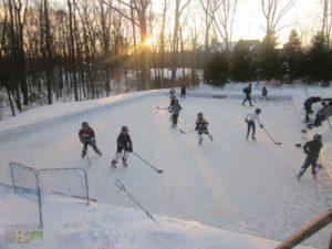 Kids playing hockey on frozen lake