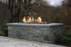 Stone fire pit in a backyard