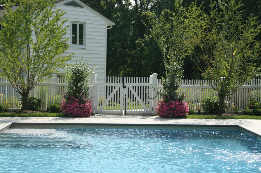 Pool with white fence and gate around