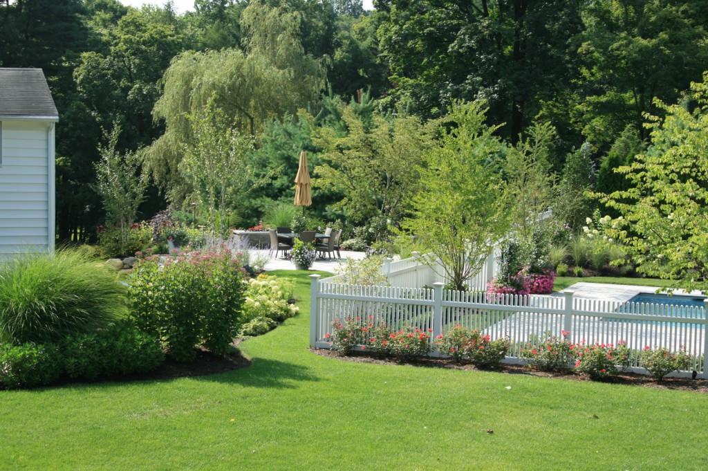 White fence surrounding pool