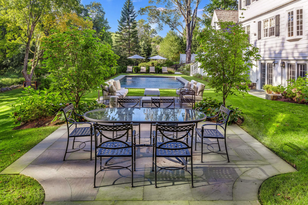 Outdoor seating set with pool and beautiful trees