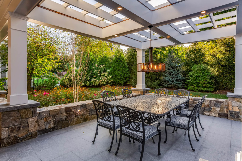 Table and chairs surrounded by landscaping