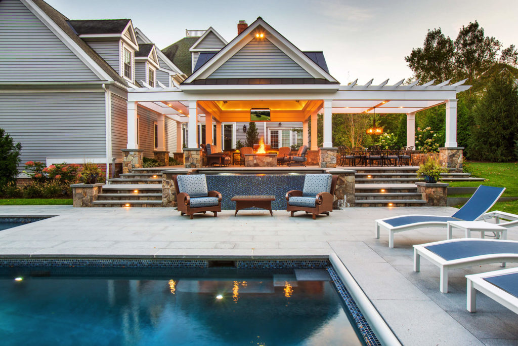 Large house with stone patio and great landscaping