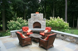Stone fireplace outside on patio