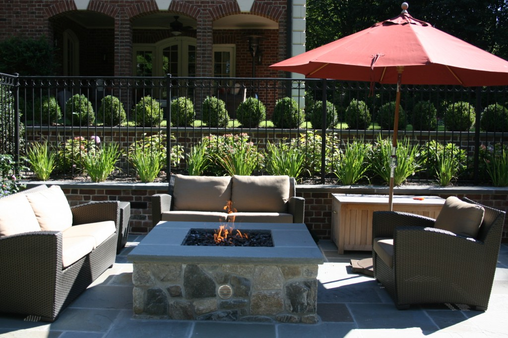 Stone fire pit with couches around it