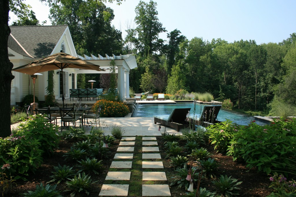 Stone tiles leading to pool and pool house
