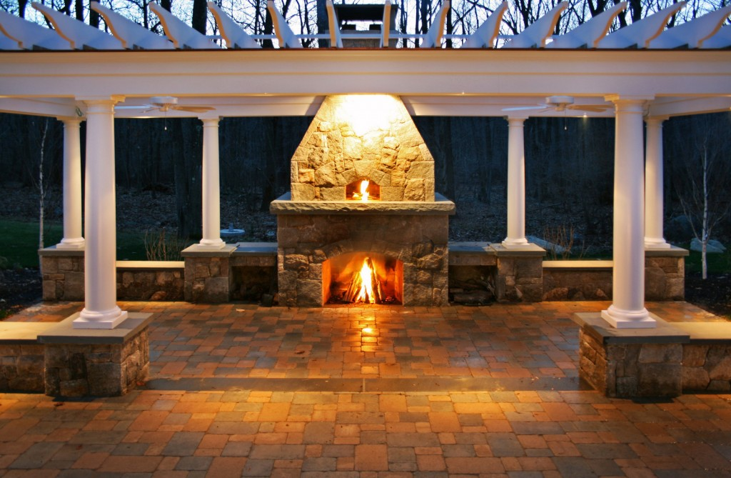 Outdoor fireplace lit up at night
