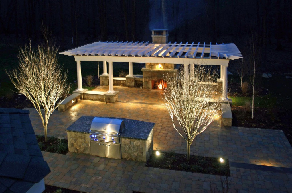 Grill and outdoor fireplace at night