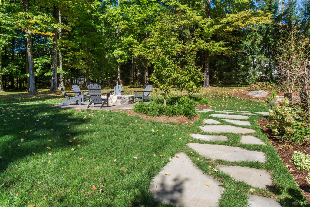Stone walkway leading to fire pit