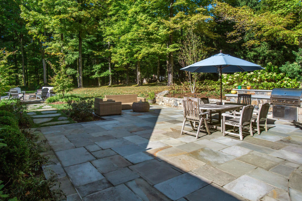 Stone patio with table and outdoor kitchen