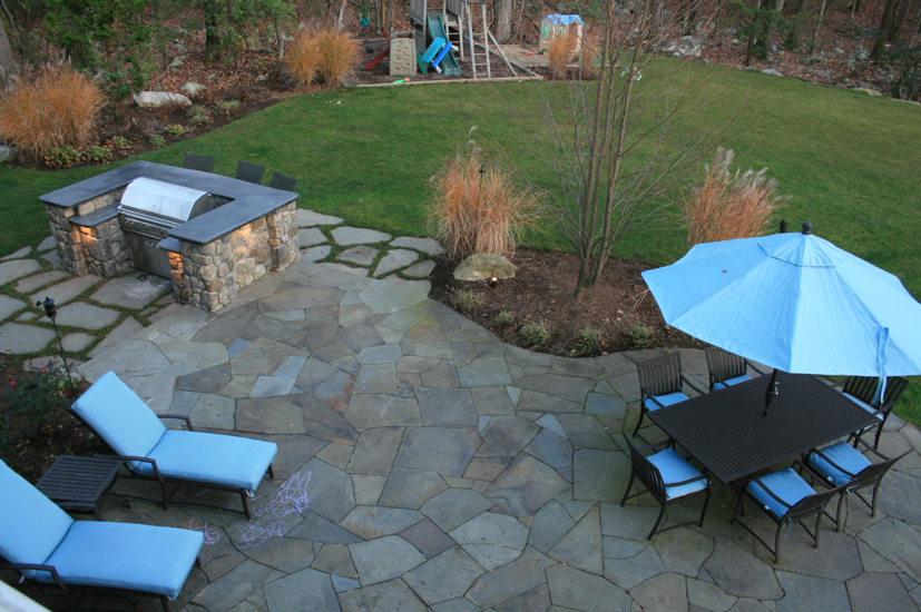 Stone patio with table and chairs