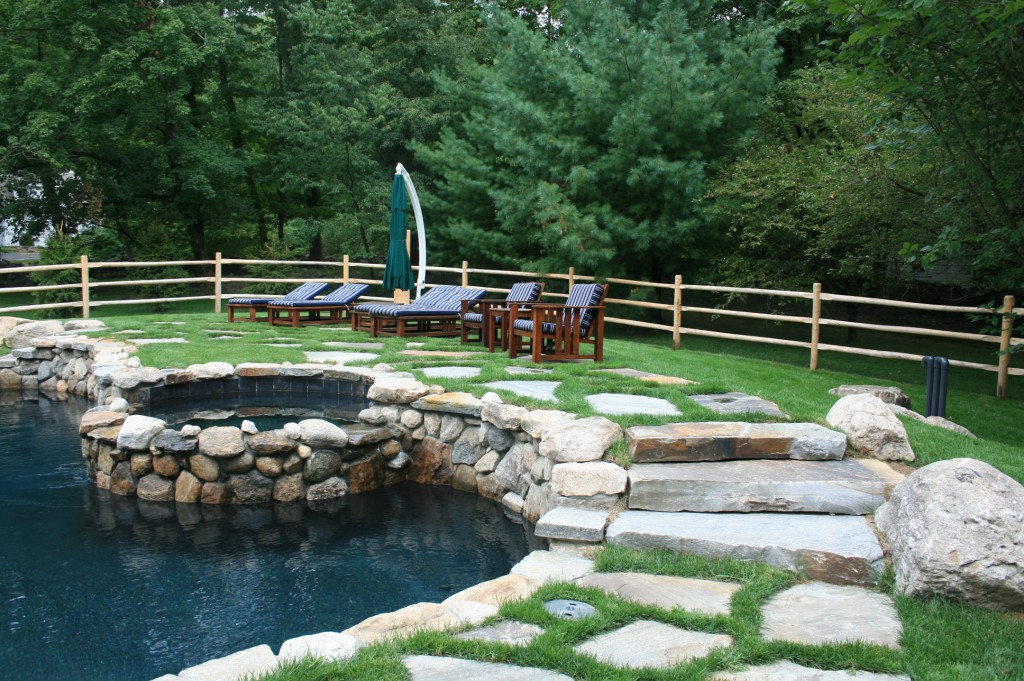 Stone steps with pool and hot tub
