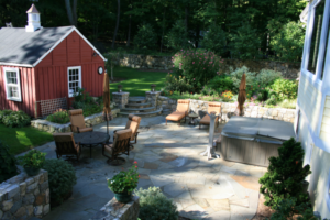 Stone patio with table and hot tub