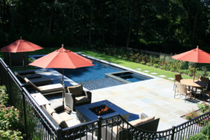 Backyard pool with hot tub and stone patio