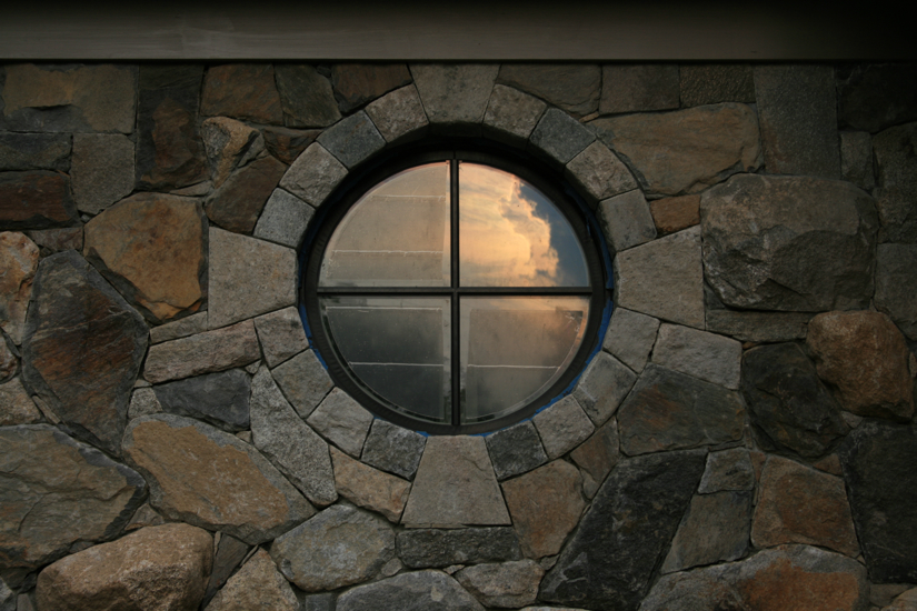 Circular window in stone wall