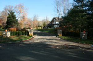 Driveway with leaves on it