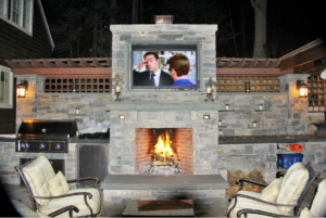 Fireplace with TV above outside
