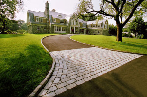 Stone apron of driveway leading to large house