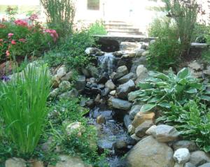 Stone waterfall in backyard