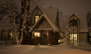 snow covered house at night