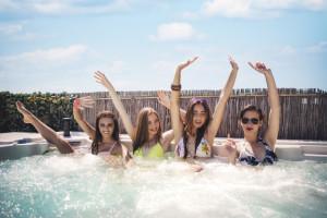 4 women in hot tub