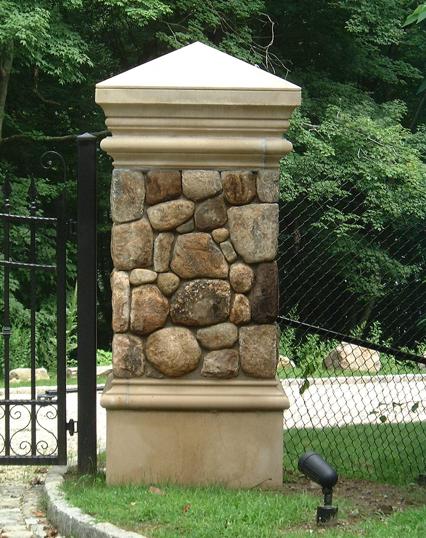 Stone pillar next to a gate