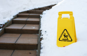 Caution sign next to slippery steps