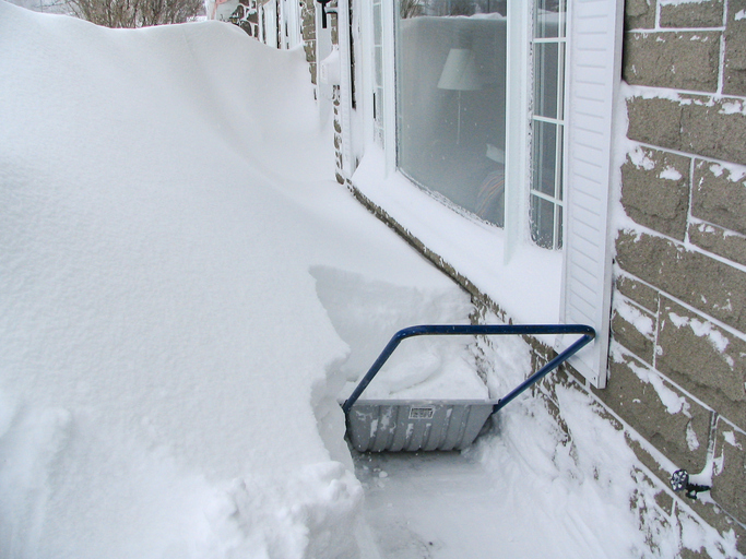 A huge snow storm left more than one meter of snow in front of the house